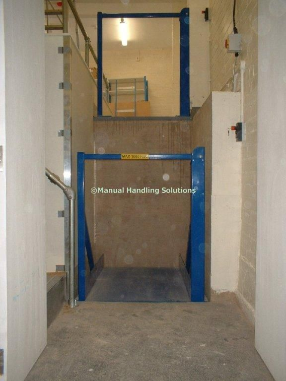 Split Level Retail Roll Cage Lift